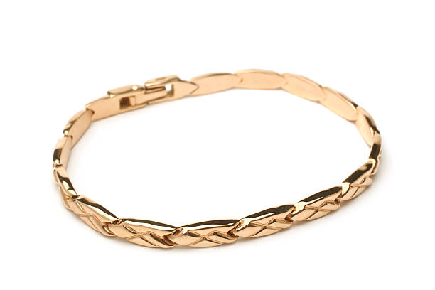 Gold bracelet Gold bracelet on white background wristband stock pictures, royalty-free photos & images