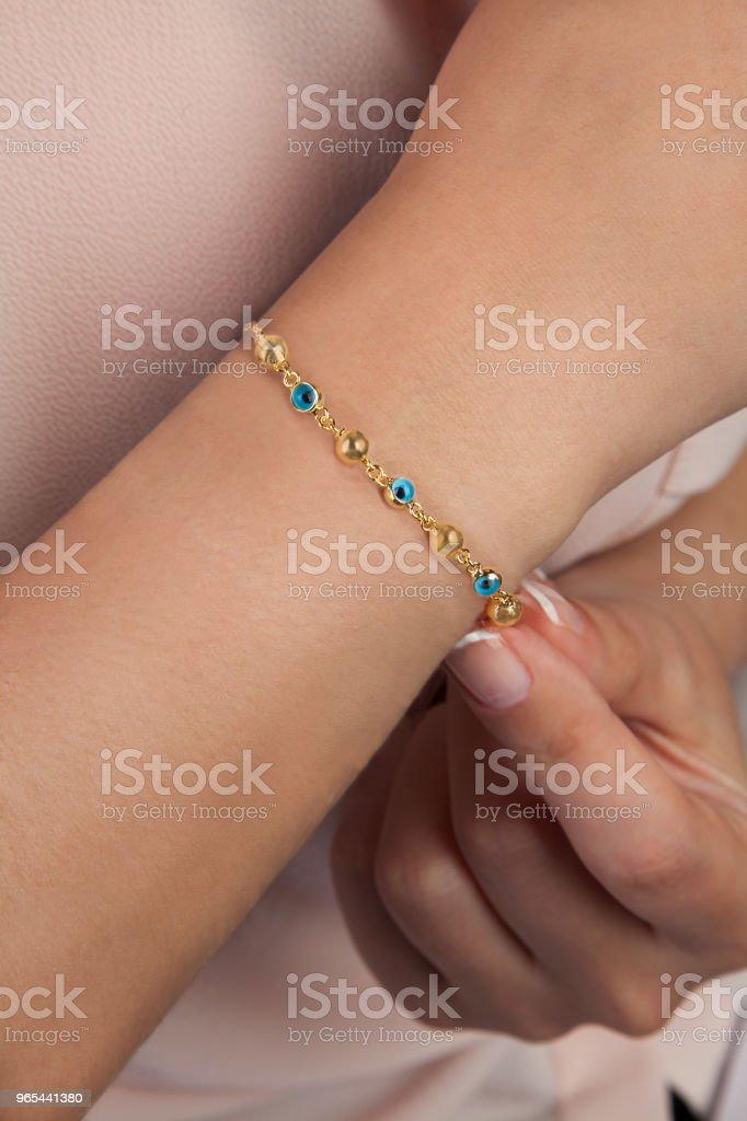 Gold Bracelet with Evil Eye Stones zbiór zdjęć royalty-free