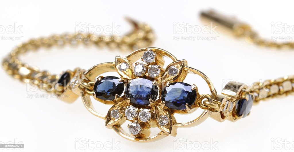 Gold bracelet with sapphires and diamonds royalty-free stock photo