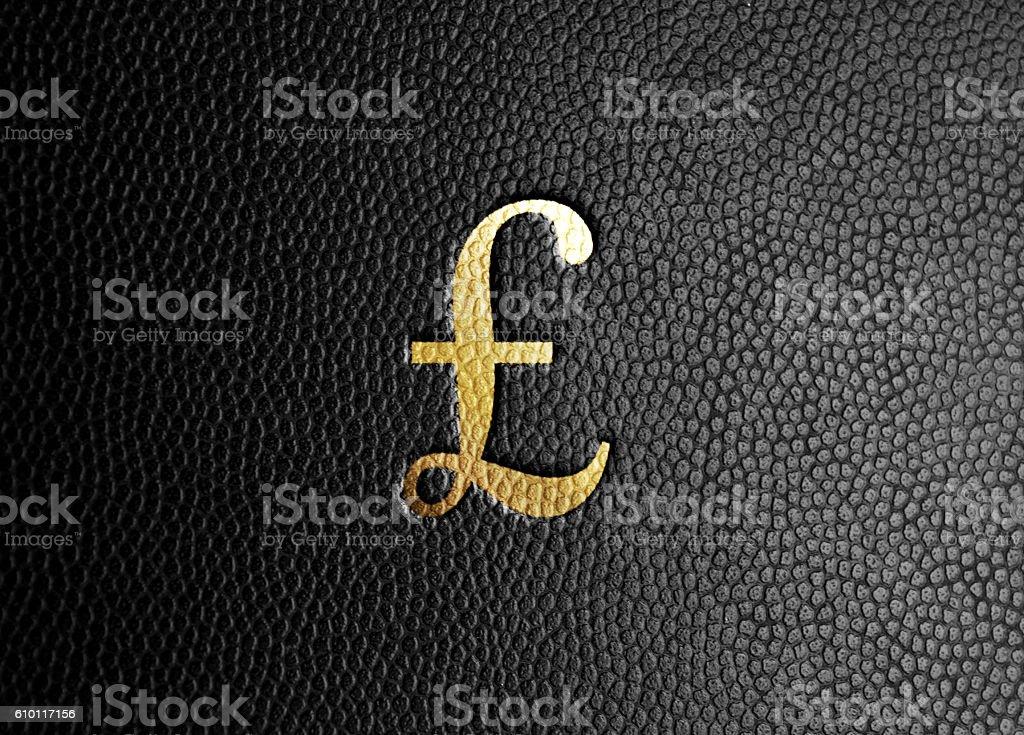 Gold British Pound Symbol on Black Leather stock photo