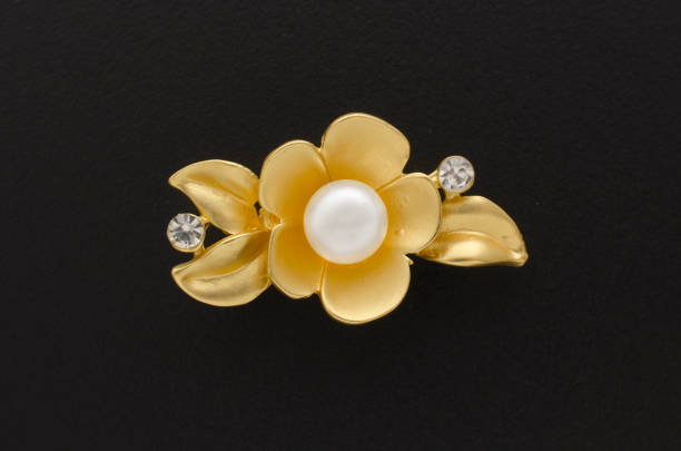 97e018595a0ea Gold Brooch Flower With Pearl Isolated On Black Stock Photo & More ...