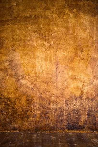 gold braun hintergrundpapier mit vintage grunge hintergrundtextur mit schwarzen kanten abgewetzt und alten verblichenes antikes-design hat textfreiraum für anzeige broschüre oder ankündigung einladung, abstrakten hintergrund - kupferfarbe stock-fotos und bilder