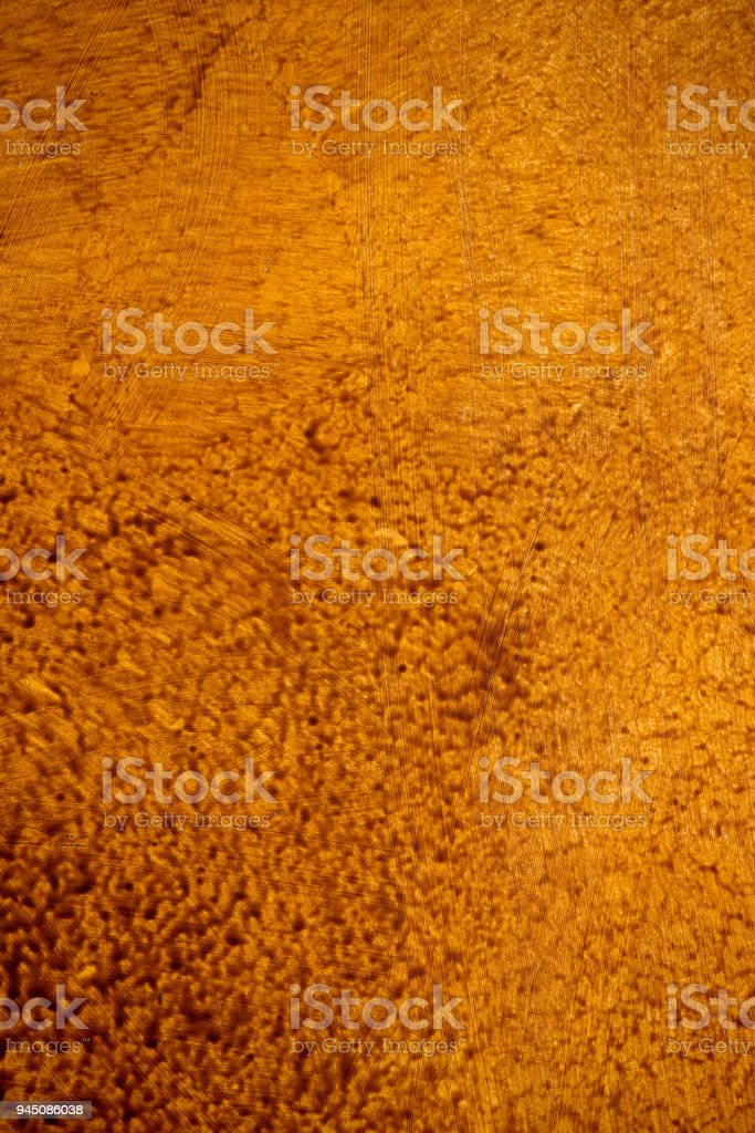 gold brown background paper with vintage grunge background texture with black scuffed edges and old faded antique design has copy space for ad brochure or announcement invitation, abstract background стоковое фото