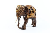 Gold Brown Black elephant made of resin like wooden carving with white ivory. Stand on white background, Isolated, Art Model Thai Crafts, For decoration Like in the spa. Engraved pattern.