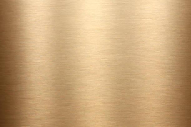 gold brushed metal texture - messing stockfoto's en -beelden