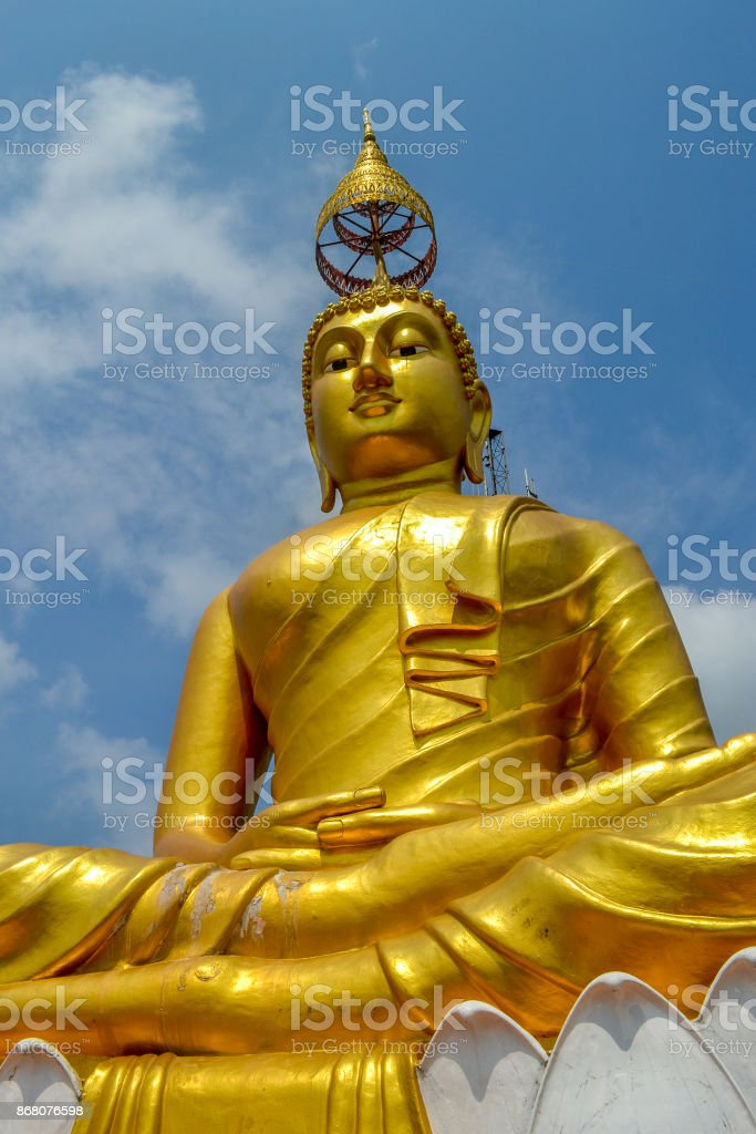 Gold Buddha statue in Tiger Cave Temple near Krabi Thailand stock photo