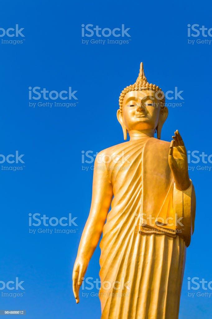 Gold Buddha Statue on blue sky royalty-free stock photo