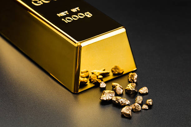gold bullion and nuggets - gold mine stock photos and pictures