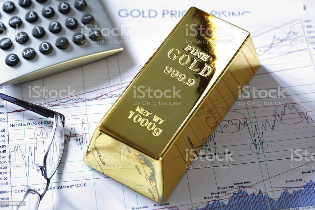 Gold bullion bar on a stocks and shares chart stock photo