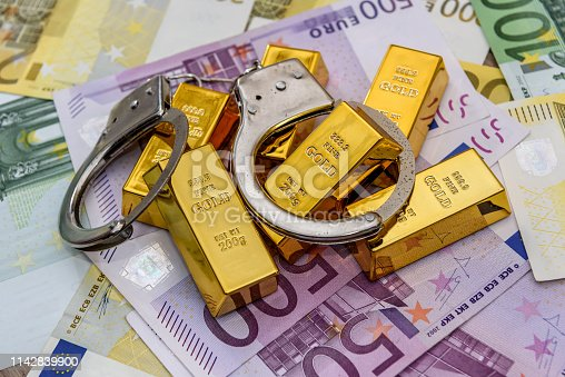 1024130248istockphoto Gold bullions with handcuffs at euro banknotes background 1142839900