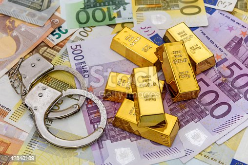 1024130248istockphoto Gold bullions with handcuffs at euro banknotes background 1142840189