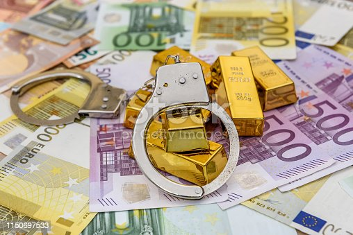 1024130248istockphoto Gold bullions with handcuffs at euro banknotes background 1150697533