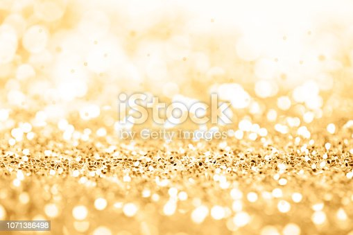 823240022 istock photo Gold celebration background for anniversary, New Year Eve, Christmas, falling coins, wedding or birthday 1071386498