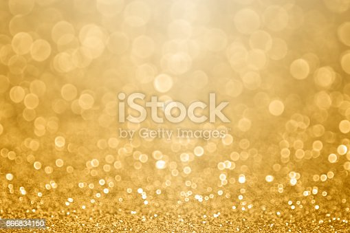 istock Gold celebration background for anniversary, New Year Eve, Christmas, falling coins, wedding or birthday 866834150