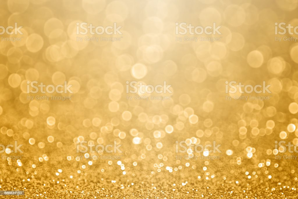 Gold celebration background for anniversary, New Year Eve, Christmas, falling coins, wedding or birthday stock photo