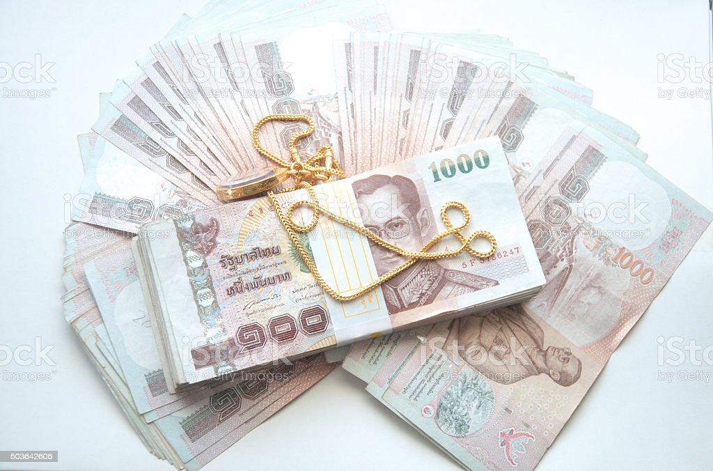 Gold chain and Thai money stock photo