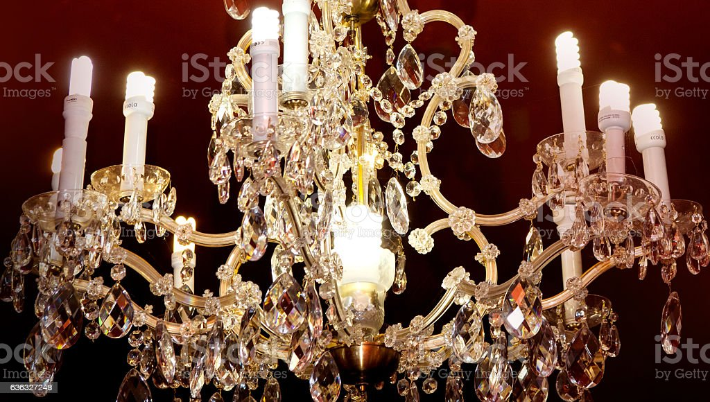 Gold Chandelier And Candle On Burgundy Background Royalty Free Stock Photo