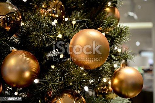 istock Gold Christmas Balls on tree 1045859676