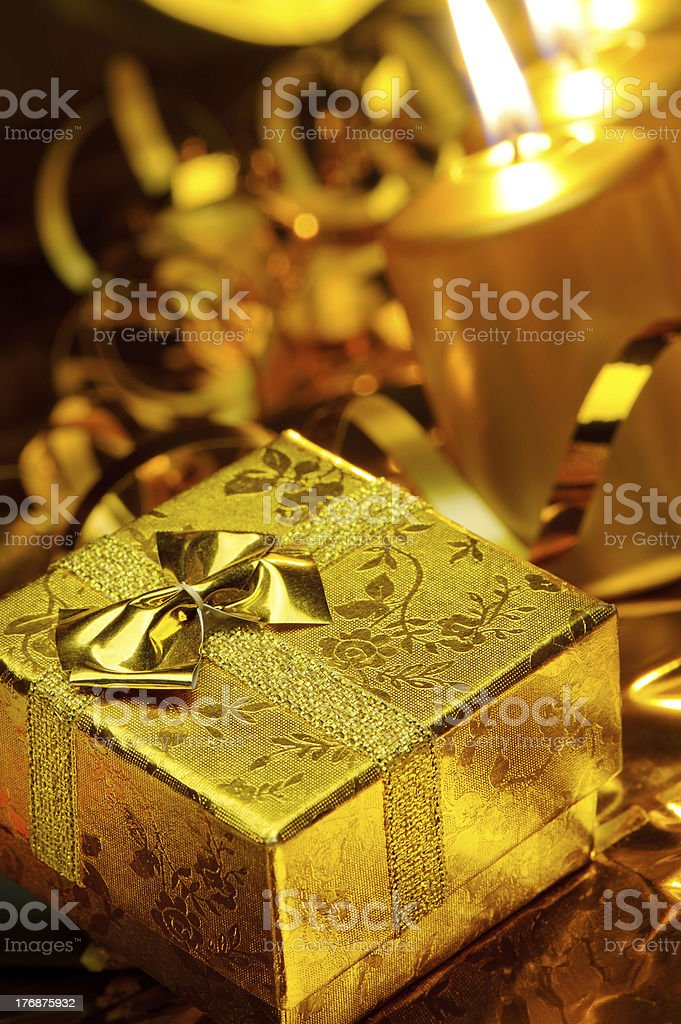 Gold christmas candles and gift boxes royalty-free stock photo