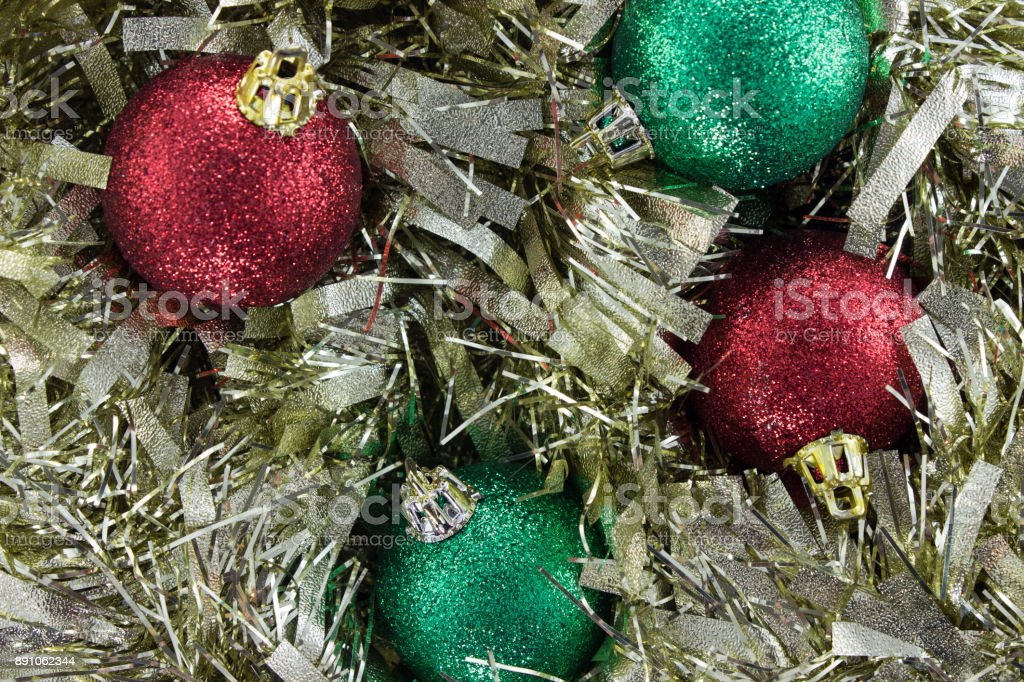 Red Christmas Ball Ornaments.Gold Christmas Garland With Red And Green Christmas Ball Ornaments Stock Photo Download Image Now