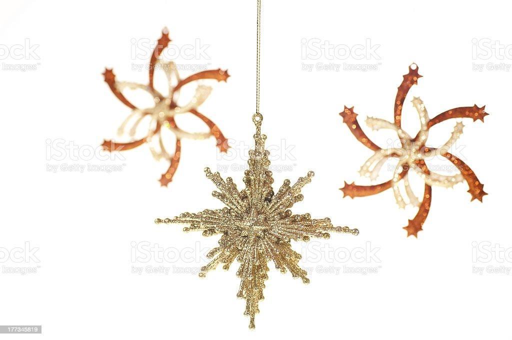 Gold Christmas hanging stars ornament stock photo