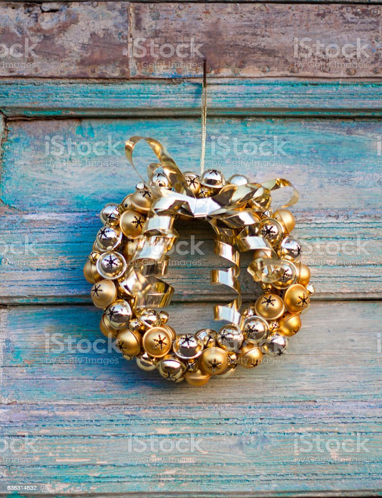 Gold Christmas Wreath On Distressed Blue Door (Close-Up Detail) stock photo