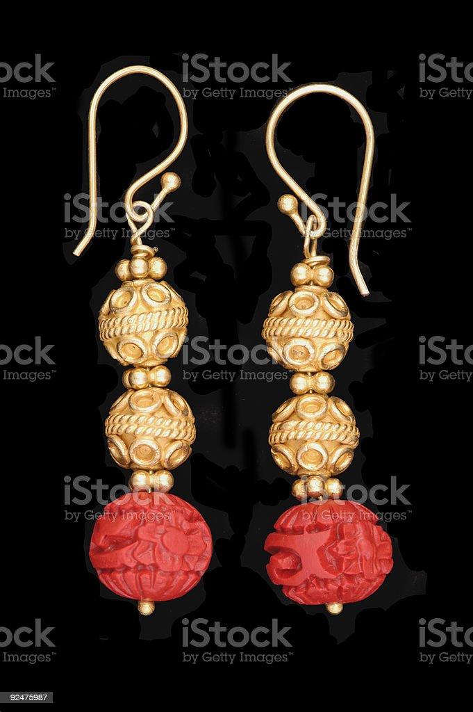 Gold Cinnabar Earrings royalty-free stock photo