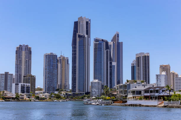 Gold Coast canal view with highrises and small waterfront houses stock photo