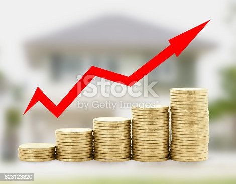1039640896istockphoto Gold coin diagram with arrow on home blur background 623123320