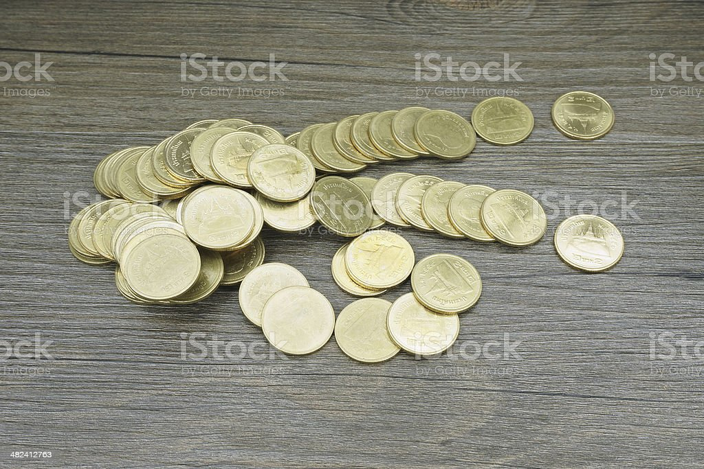 Gold coin of Thai baht disperse royalty-free stock photo