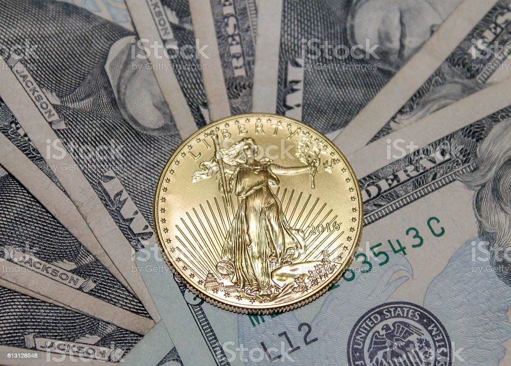 Gold Coin On Top Assorted Twenty Dollar Bills stock photo