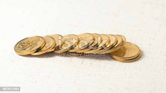 istock Gold coin 882824564