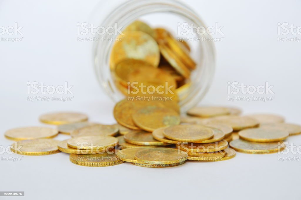 gold coin pour from glass bottle 免版稅 stock photo