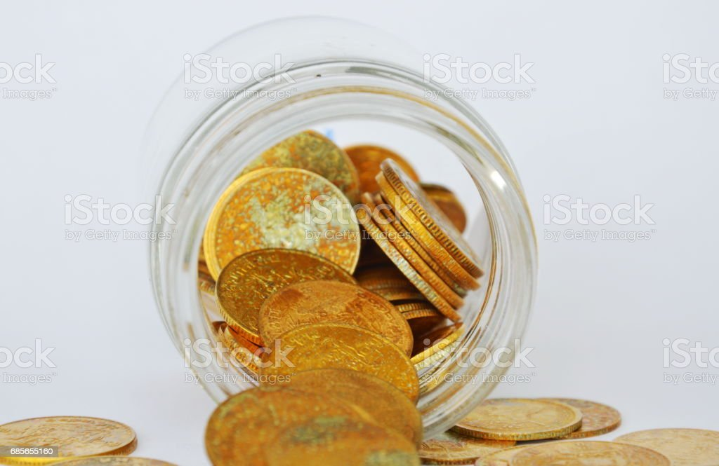 gold coin pour from glass bottle foto de stock royalty-free