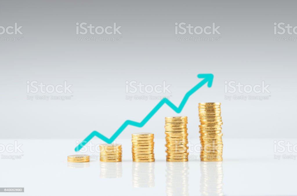 gold coin stack grow up stock photo