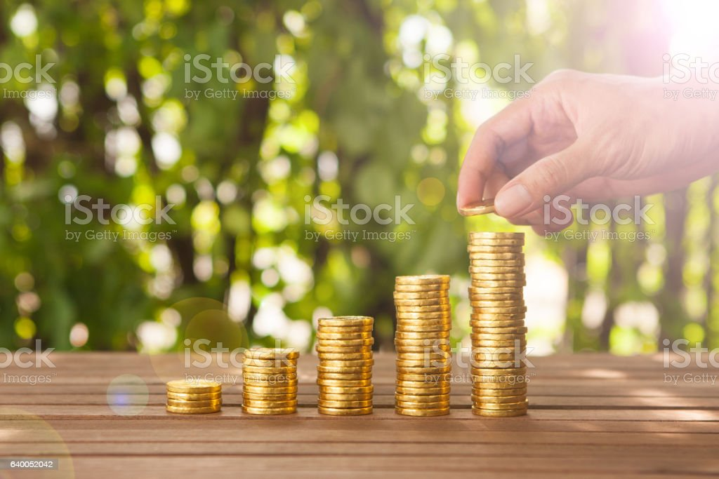 Gold coin stacked growing. Saving money concept stock photo