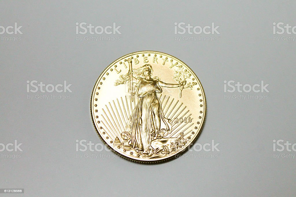 Gold Coin US Currency stock photo