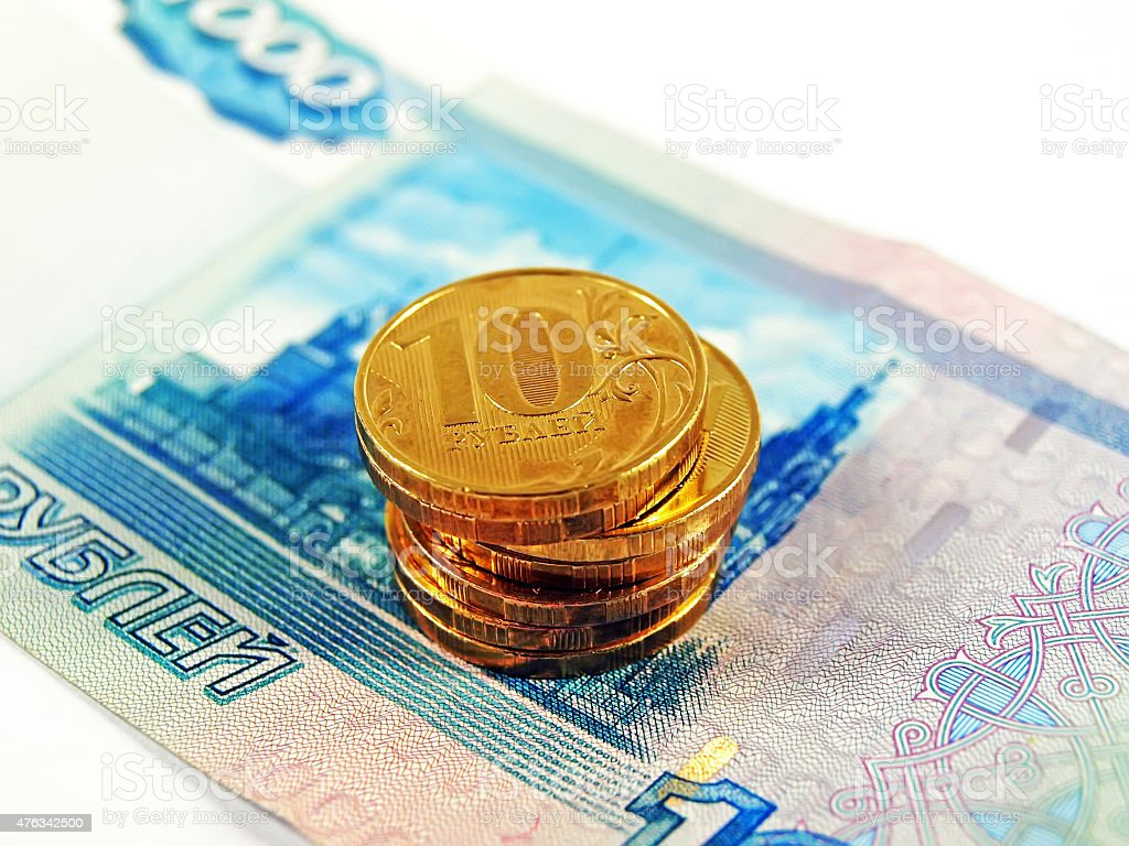 Gold coins and russian one thousand rubles stock photo