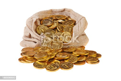 482747823istockphoto Gold coins fall out of a canvas bag 186998850