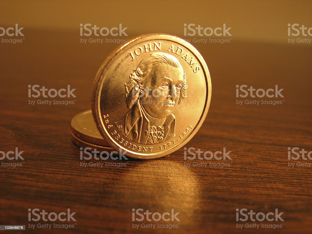 Gold coins on a table royalty-free stock photo