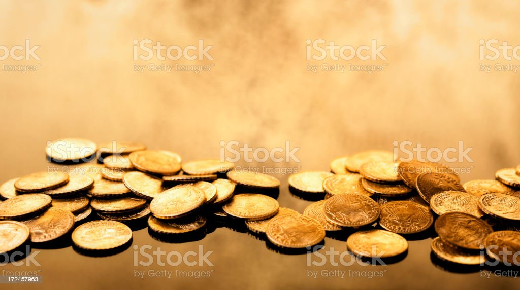 Gold coins on infinite background stock photo