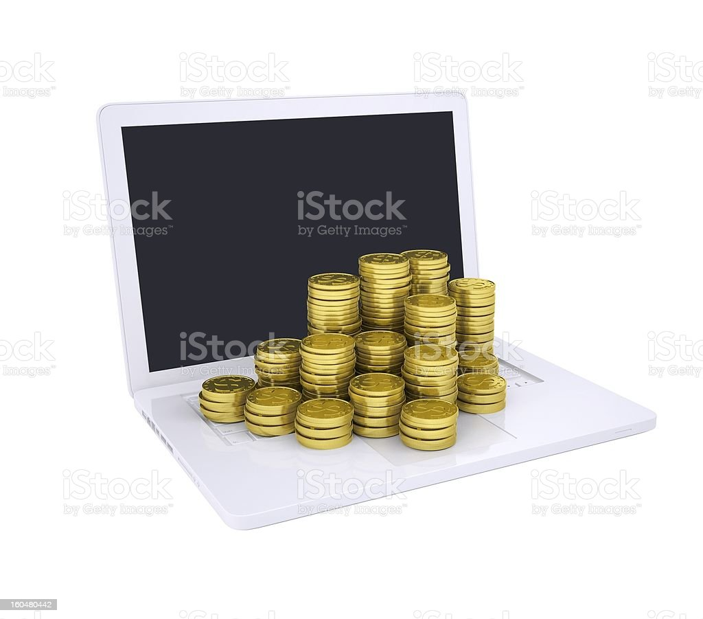Gold coins on the laptop royalty-free stock photo