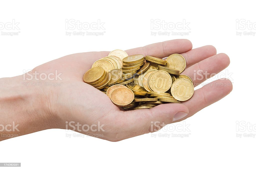 Gold coins on the palm of your hand royalty-free stock photo