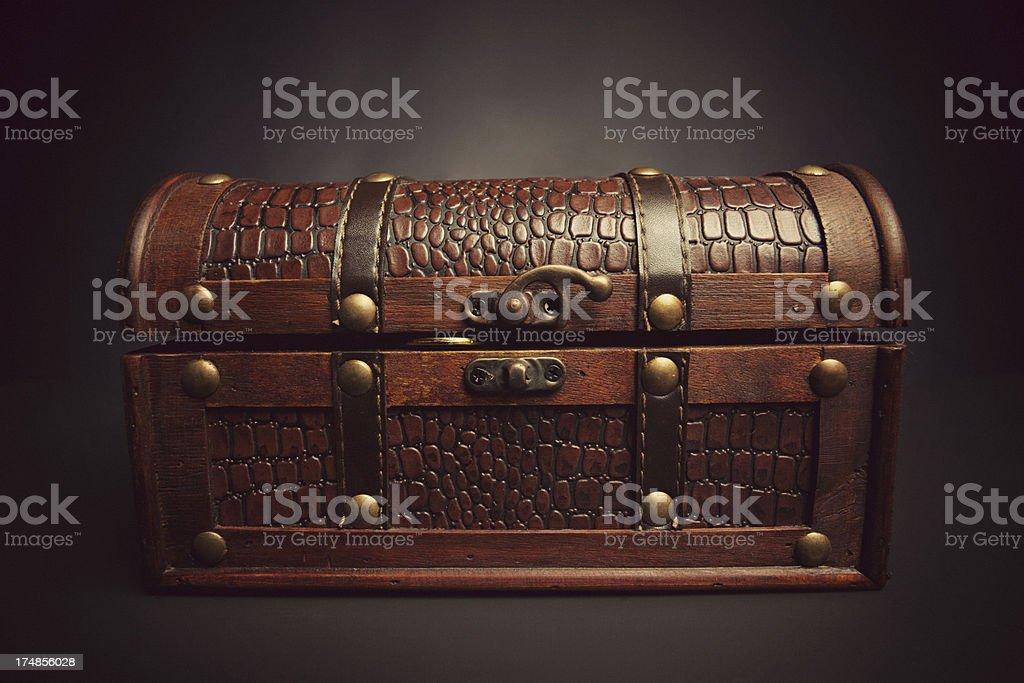 gold coins peeking through treasure chest royalty-free stock photo