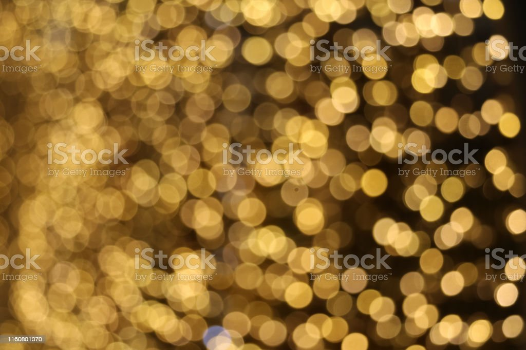gold color abstract of blur and bokeh colorful light interior and...