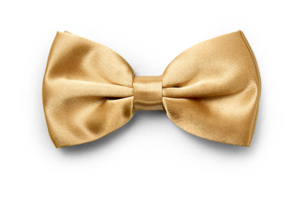 Gold color bow tie isolated on white background with clipping path Gold color bow tie isolated on white background with clipping path bow tie stock pictures, royalty-free photos & images