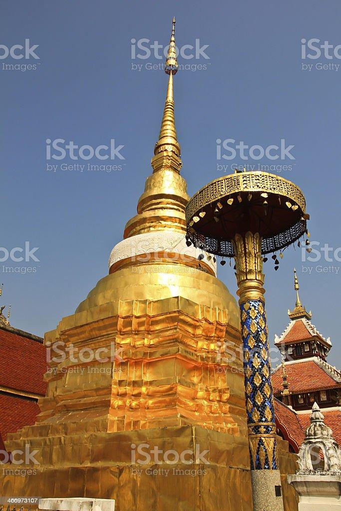 Gold color pagoda in Wat Pong Sanook at Lampang Thailand royalty-free stock photo