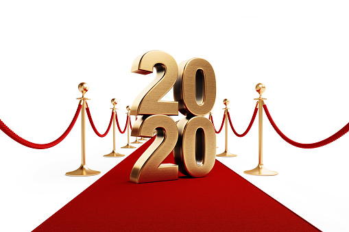 istock Gold Colored 2020 Standing on A Red Carpet - Red Carpet Event Concept 1174517165