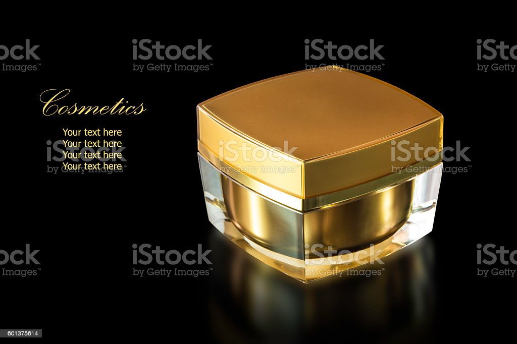 Gold colored blank cosmetic container for face cream moisturizer stock photo