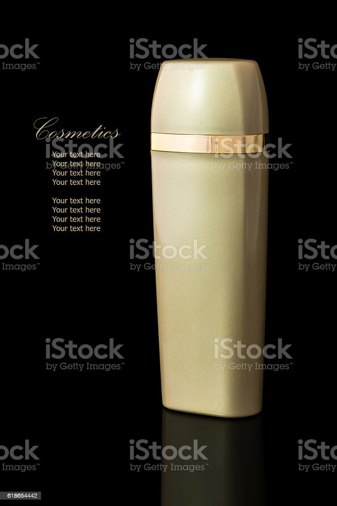 Gold colored blank cosmetic container stock photo
